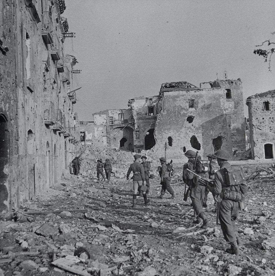 'A' Company, 2nd Battalion, The Lancashire Fusiliers, advancing through Aquino, Italy, May 1944..jpg